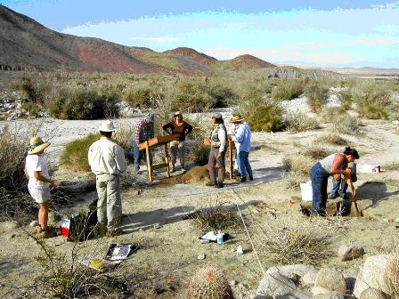 Joan Schneider (in center with vest and cap) in field with members of Colorado Desert Archaeology Society at Anza-Borrego Desert State Park.