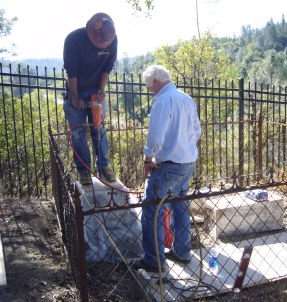 Staff making repairs to a monument in Shasta SHP Catholic Cemetery