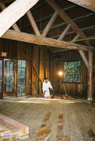 Reconstruction of the floor of the Social Hall at Mendocino Woodlands State Park is underway.