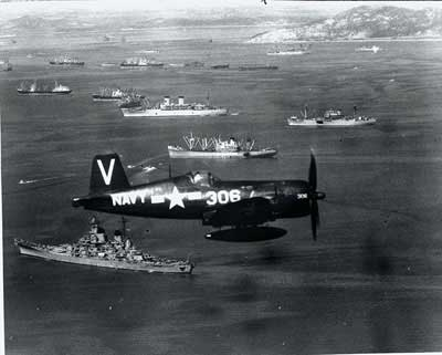 A Corsair fighter escorts the South Pacific fleet.