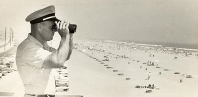 Robert Isenor surveys the beach from the Huntington Headquarter, 1950's