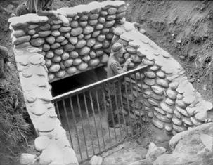 CCC crew member working on stone culvert in 1936