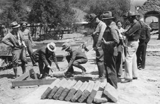 CCC administration laying of the first brick to start reconstruction in 1936