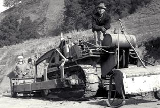 CCC crew member on road building tractor in 1935