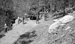 CCC clearing the roadside on truck trail in 1934