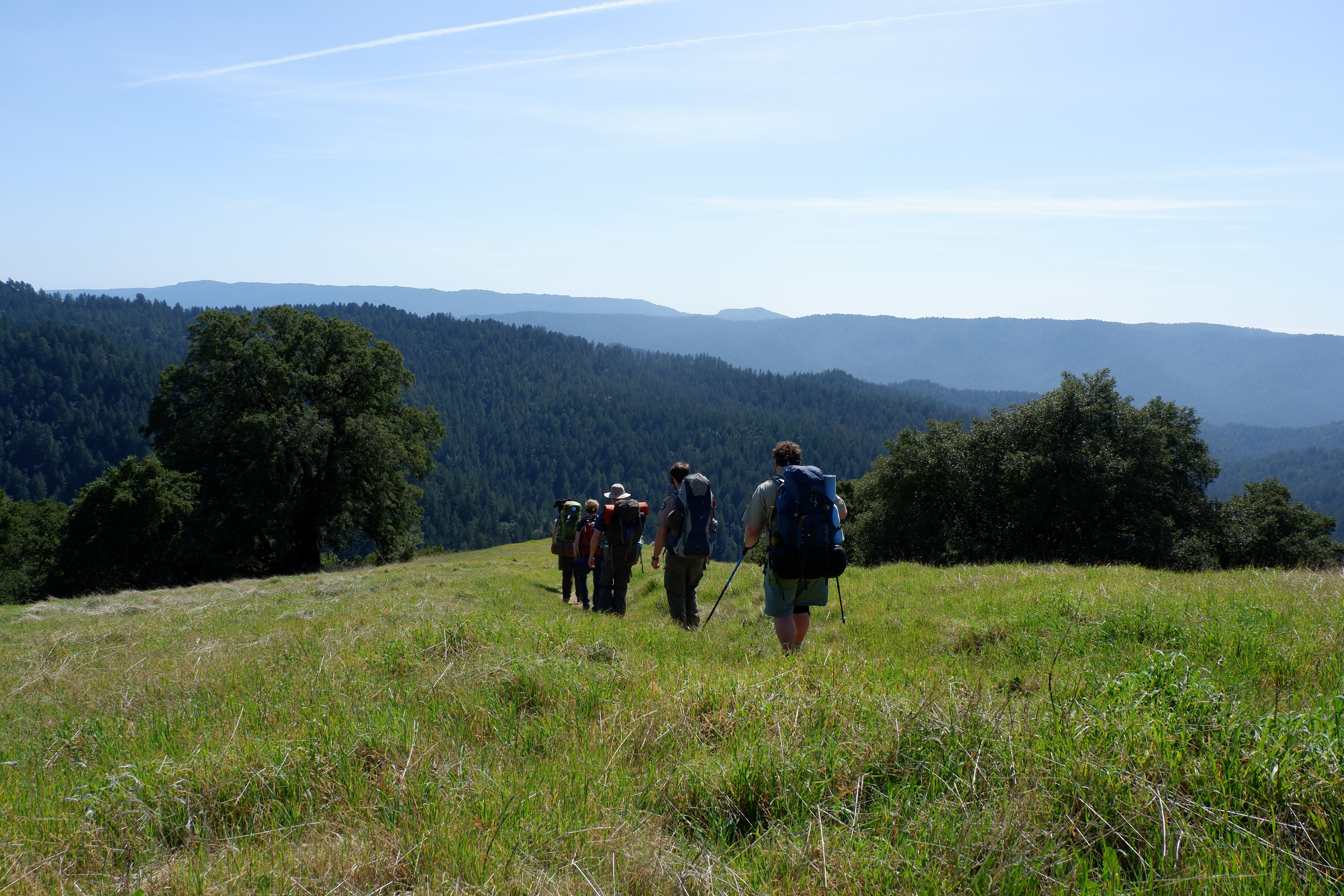 Image of hikers on trail<span id=
