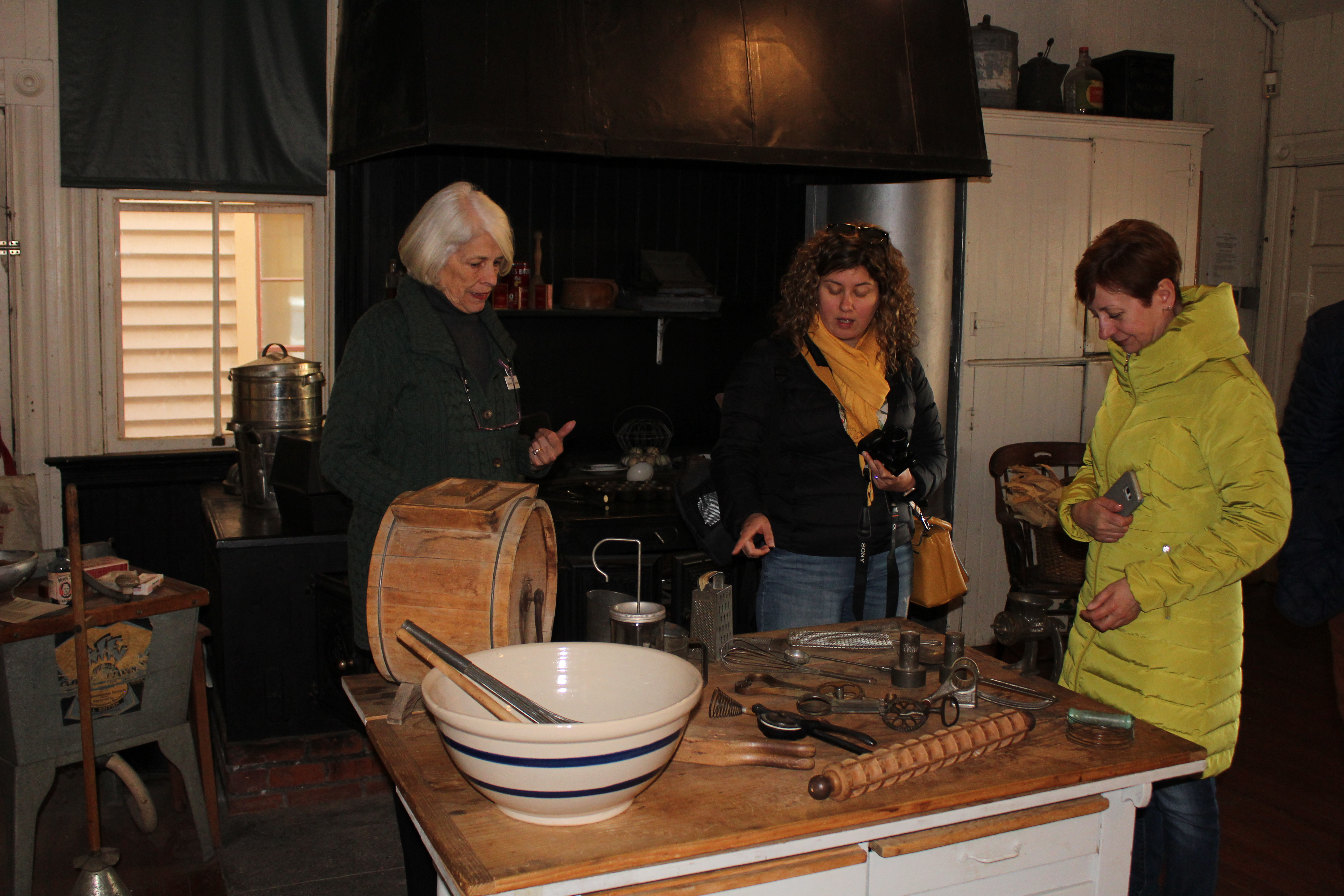 visitors touring toscano kitchen with docent