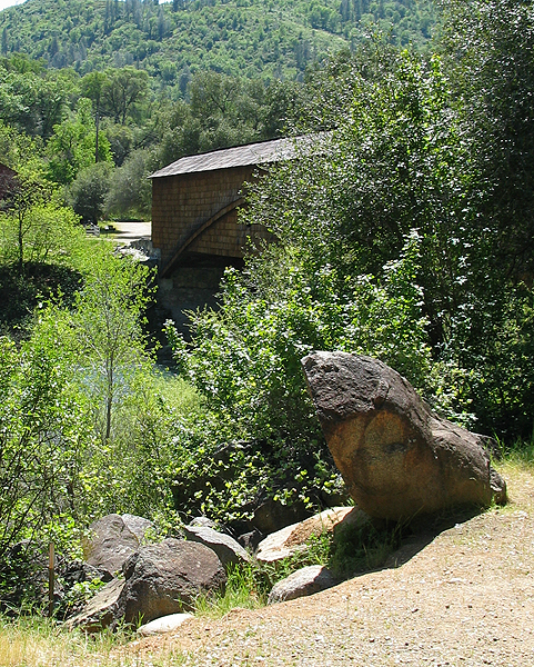 Partial view of Bridge with Rock and Vegetation