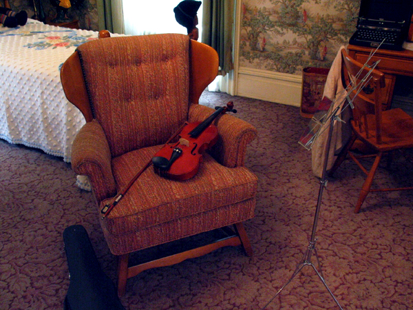 Chair with Violin in Child's Room.