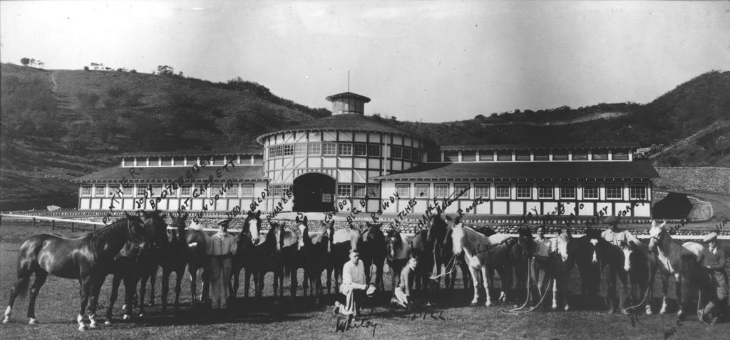 Will Rogers and his horses in front of his stable, circa 1933.