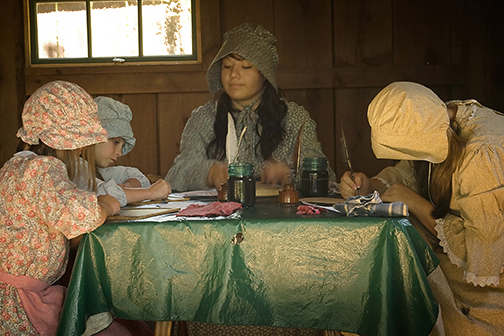 Life in the 1850's---high school docent and participants